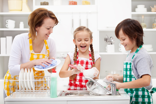 This is totally me and my two kids dressed in matching aprons and laughing as we wash perfectly clean dishes in a perfectly clean kitchen. What? You don't know.